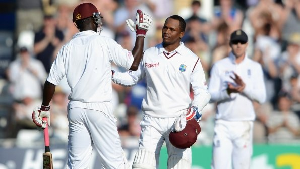Marlon Samuels (right) is congratulated by Darren Sammy