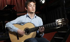 Classical Star: Ian plays the Guitar