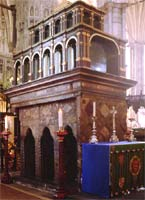 Edward's shrine in Westminster Abbey, a tall pillared box surrounded by candles
