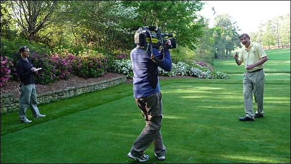 The BBC TV crew film on the 13th tee at Augusta