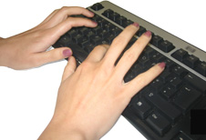 silver and black keyboard with two hands typing