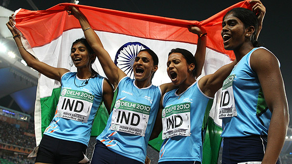 The Indian 4x400 relay team celebrates winning gold at the Commonwealth Games