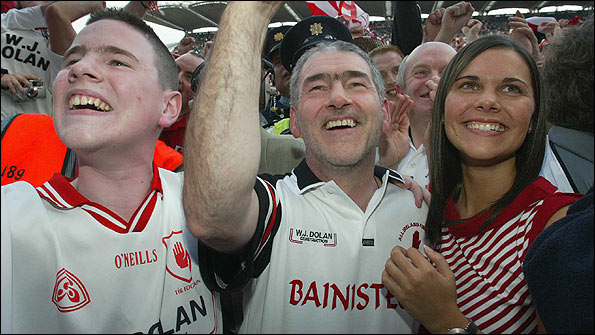 <small><em>Michaela Harte celebrated Tyrone's win in the 2003 All-Ireland final with brother Matthew and father Mickey, manager of the team</em></small>