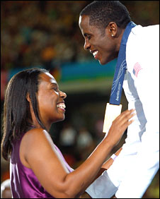 Dwight Phillips receives his gold medal from Marlene Dortch