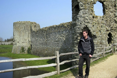 Dan Snow stands outside Pevensey Castle in Sussex