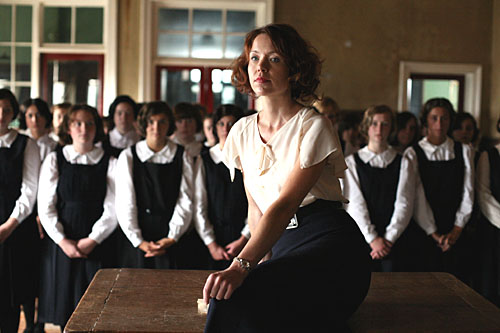 Anna Maxwell Martin as Sarah Burton in South Riding, surrounded by schoolchildren