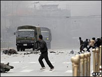 Tibetans throwing stones at army vehicle in Lhasa, Tibet