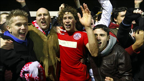 Sergio Torres celebrates his winner with the Crawley fans