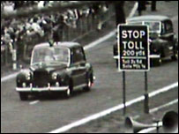 Royal car makes its way past toll sign
