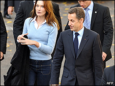The president of France's wife, Carla Bruni, wearing trousers