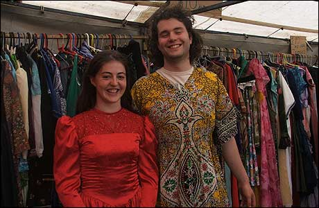 A couple get into the flamboyant spirit with a trip to the fancy dress stall