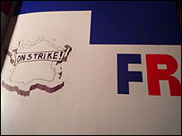 Artwork showing France with label On Strike!