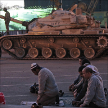 Protesters at evening prayer near tanks in Egypt