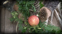 Attach fruit and pinecones