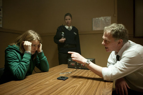 Paul Begley, played by Conor Mullen, interviews Amelia, played by Genevieve Barr