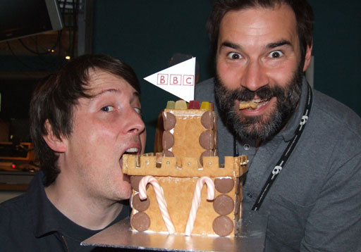 Adam and Joe eating the gingerbread Big British Castle.