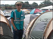 Alex standing by the tents