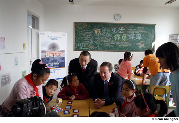 British Prime Minister David Cameron talks to local scheoolchildren in Beijing