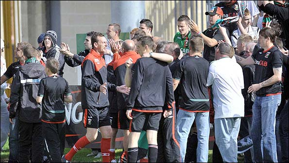 Glentoran players and management help to calm things down at Shamrock Park on Saturday