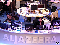 Al-Jazeera English staff prepare in their Doha news room in Qatar