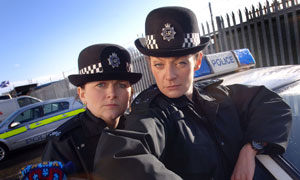 Rosie Cavaliero as PC Sally Frank and Michelle Gomez as PC Sally Bobbins