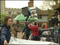 The film crew get ready in the village square