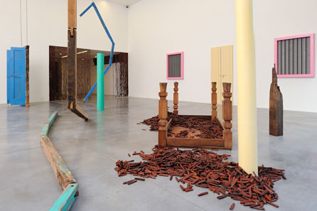 Sheela Gowda, Of All People, 2011. Wood, metal, Print on paper. Installation, variable dimension
