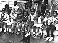 Children watching a black voting rights march in Alabama.  Martin Luther King led the march from Slema, Alabama, to the state capital in Montgomery
