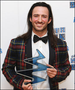 Aaron Sillis poses with The Times Breakthrough Award the South Bank Show Awards 2009. (Photo: Getty Images)