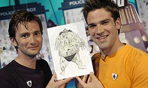 David Tennant and Blue Peter's Gethin Jones with the winning monster