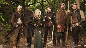 The Characters of Robin Hood in line in Sherwood Forest