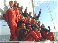 The jersey crew celebrating on board shortly after crosiing the finishing line
