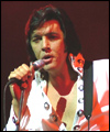 Richard Atkins as Elvis captured on stage  in Truro