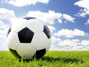 Football on grass (Image: Rene Mansi/iStockphoto)