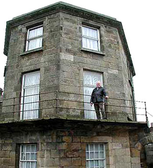 Alan Dodds stands on the balcony of the prison governor's house.
