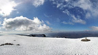 View from the snow-covered top of Ben Nevis.