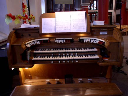 The keys of the Conacher organ, with sheet music in the holder ready to play