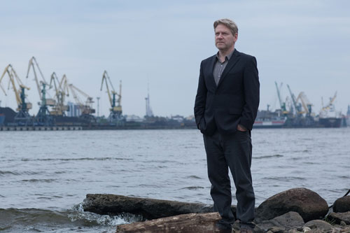 Kurt Wallander (Kenneth Branagh) stands alone in the bleak landscape