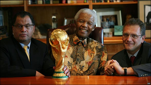 Danny Jordaan, Nelson Mandela and Jerome Valcke with the World Cup