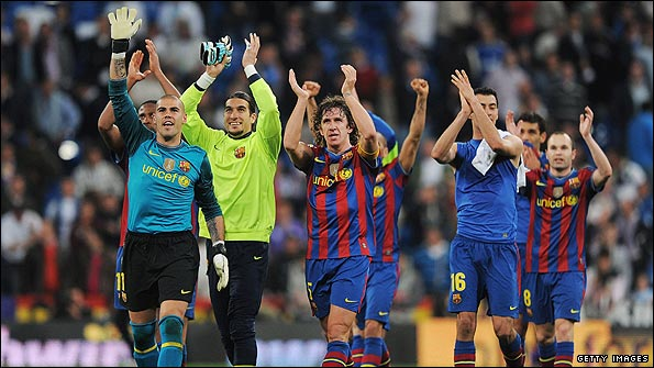 Barcelona's players, including Valdes (l) and Puyol (c) celebrate victory over Real. Pic: Getty