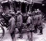 Photo of Indian officers examining the State Coach of the King-Emperor