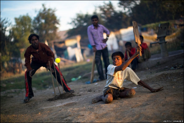 A boy disabled by the Bhopal gas leak playing cricket
