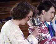 A member of the congregation drinking communion wine