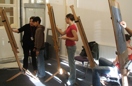 Previous students in a drawing class