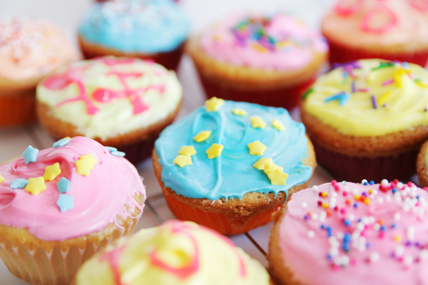 colored cup cakes @ pink candy - fotolia.com