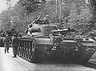 American tanks on alert in the Berlin Grunewald, West Germany, as the crisis over the Cuban blockade looms during the Cuban missile crisis (25th October 1962)