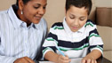 A tutor helps a boy with his school work © 'Rob @ Fotolia.com'