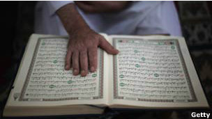 A boy reading the Koran