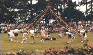 Image of people dancing around the May Pole