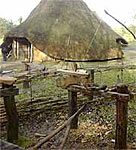 Image of a reconstructed Iron Age house and pole lathe